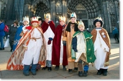 Boys dressed as the three kings outside a German Cathedral